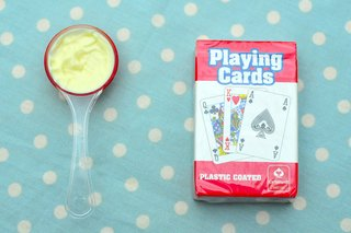 A level tablespoon of mayonnaise next to a pack of cards