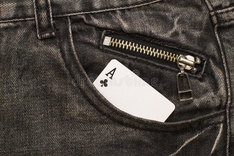 Ace card inside gray jeans pocket with zip lock. Closeup royalty free stock photography