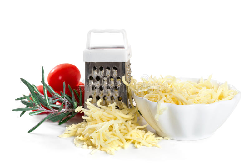 Grated cheese. With grater and tomatoes on white background stock images