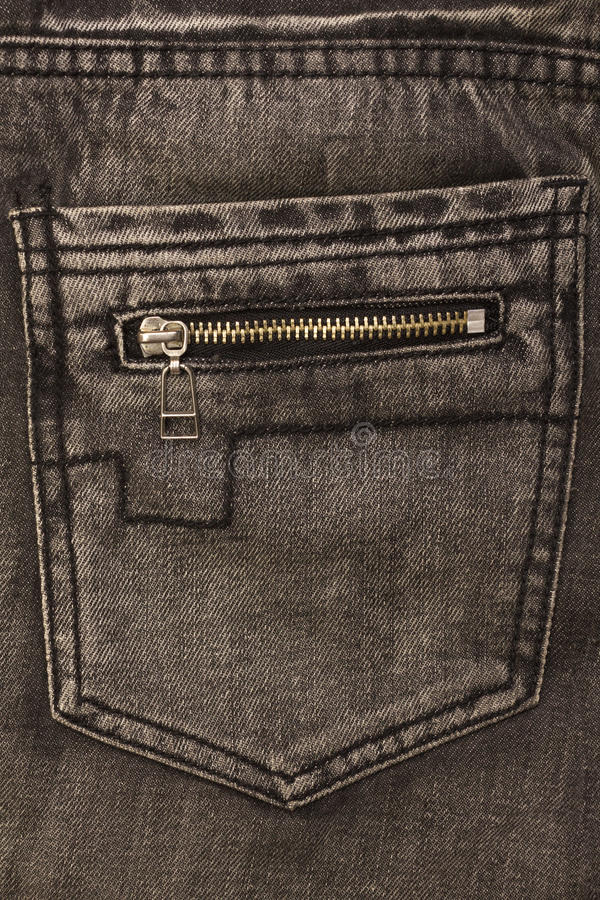 Gray jeans back pocket with zip lock. Closeup stock photography