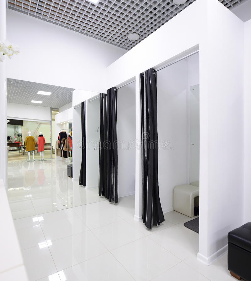 Interior of dressing room at cloth store stock photography
