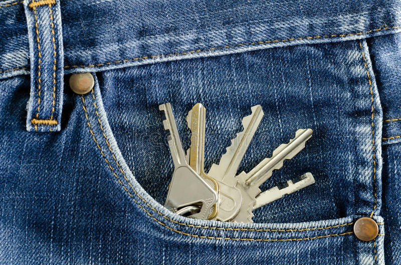 Keys in a pocket of jeans. Closeup Keys in a pocket of jeans stock photos