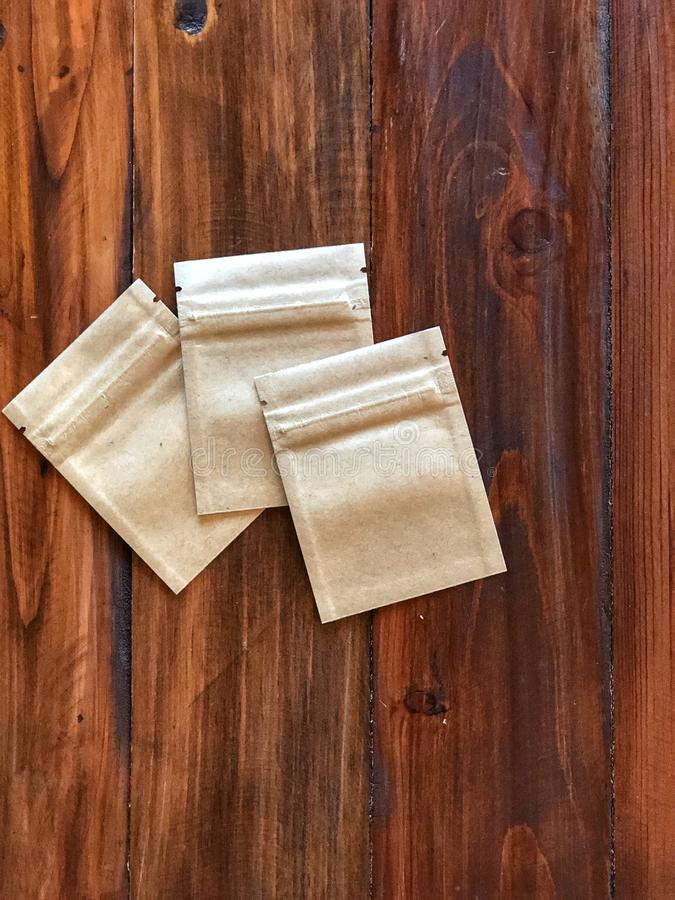 3 Kraft Paper zipper lock bag on the vintage wooden table. Empty packing bag for your product advertisement.Top view and copy space royalty free stock image
