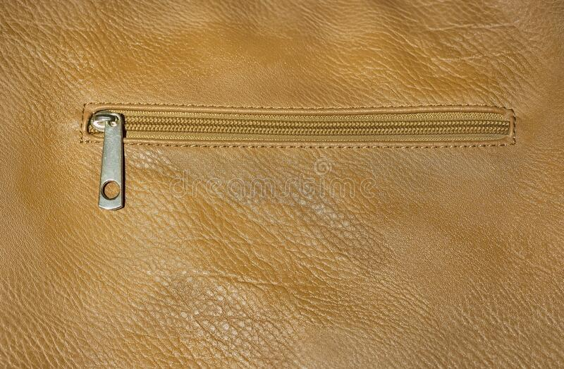 Leather with a closed lock zipper. Leather background with a closed lock zipper stock images