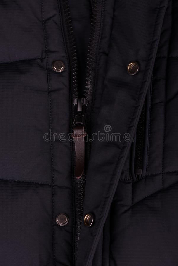 Zipper on the jacket. buttons on the jacket. The lock on the jacket. Pocket on the jacket. zipper on jacket close up royalty free stock photo