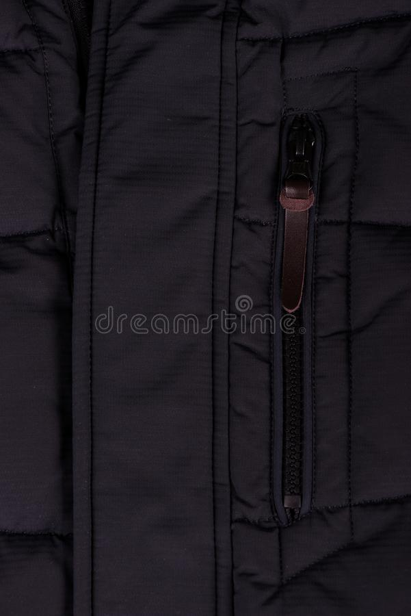 Zipper on the jacket. buttons on the jacket. The lock on the jacket. Pocket on the jacket. zipper on jacket close up royalty free stock images