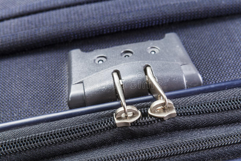 Lock with numbers on the suitcase zipper. Lock with numbers zipper of a blue suitcase stock image