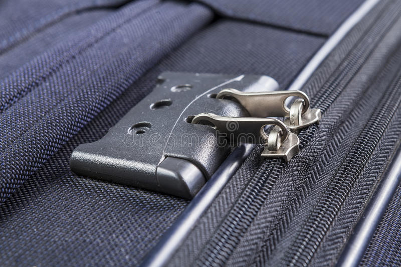 Lock with numbers on the suitcase zipper. Lock with numbers zipper of a blue suitcase stock photography