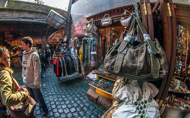 London, United Kingdom - March 31, 2007: Extreme wide angle fisheye photo of bags, clothes and other accessories on display at. Camden Lock, famous flea market royalty free stock photos