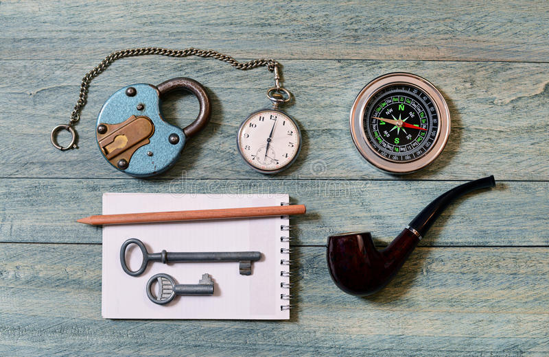 The old lock, pocket watch and compass. On the table royalty free stock image