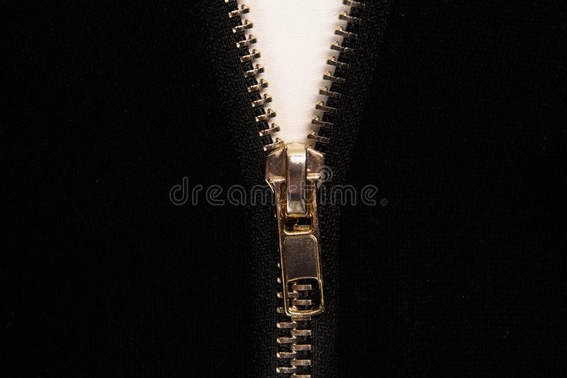 Open zipper or clothes lock on black fabric. Close up photo royalty free stock image