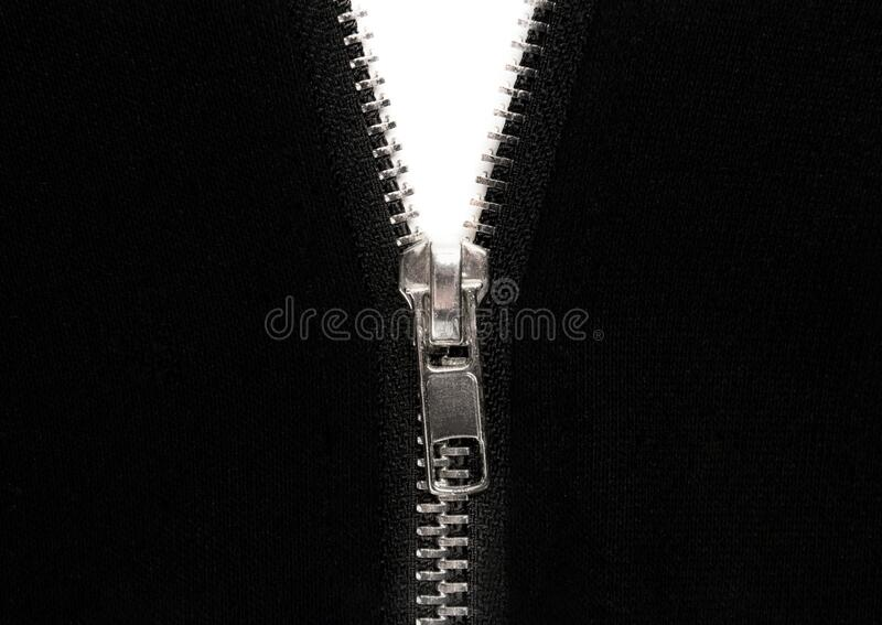 Open zipper or clothes lock on black fabric. Close up photo royalty free stock photos