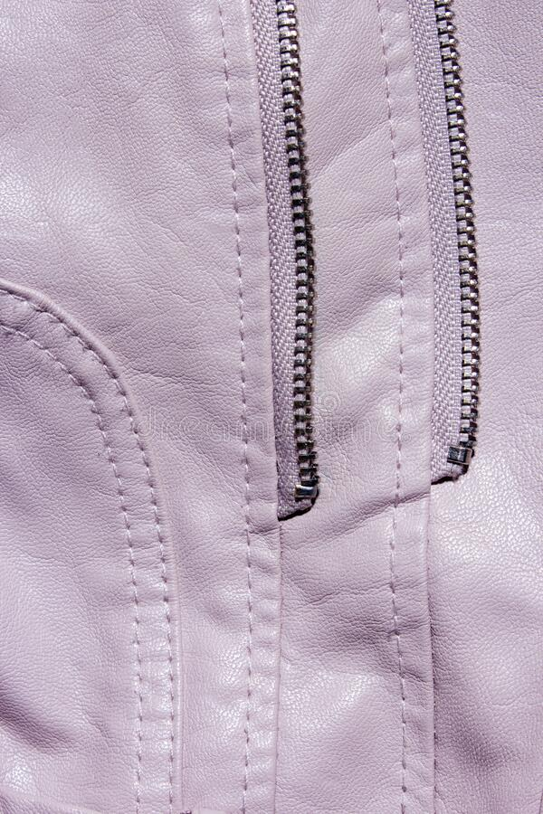 Pink Leather Background. Pink leather background with zipper from the lock. Structured background design leather. stock photo