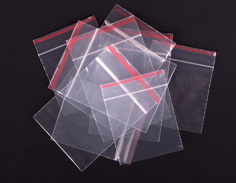 Plastic transparent zipper bag on black background. Block zip lock packaging. Empty polythene zip-lock sealed wrap. Clear pack royalty free stock image