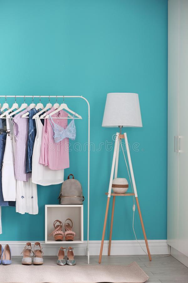 Stylish dressing room interior with rack stock images