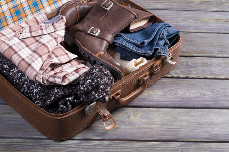 Suitcase with clothes. Retro suitcase full of things royalty free stock photo