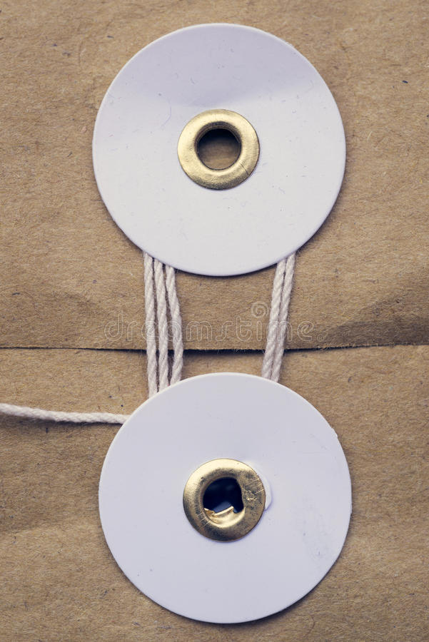 Thread lock. Paper thread lock on parcel pocket closeup stock images