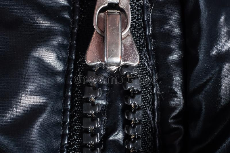 Zipper clasp with lock on the jacket in black, close-up.  royalty free stock photos
