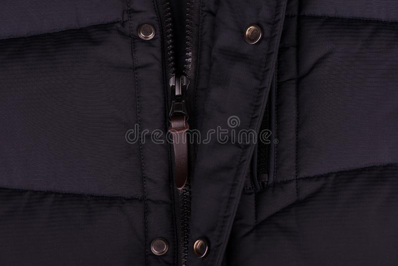Zipper on the jacket. buttons on the jacket. The lock on the jacket. Pocket on the jacket. zipper on jacket close up stock photography