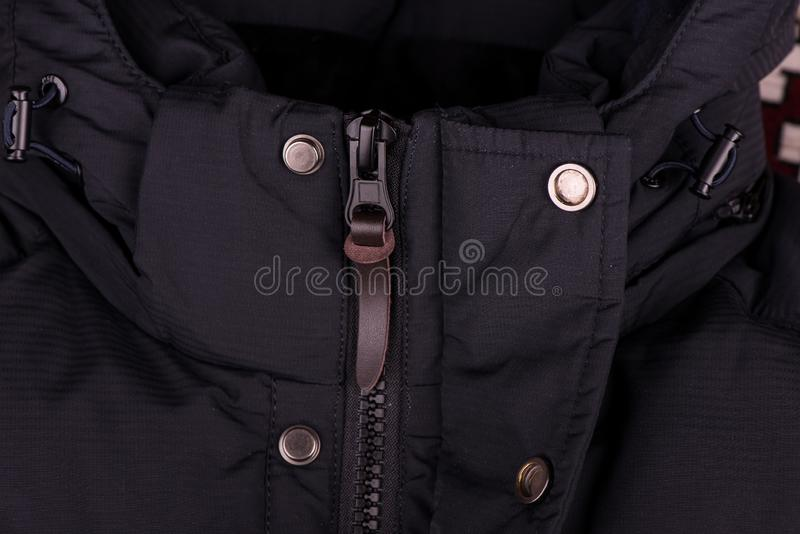 Zipper on the jacket. buttons on the jacket. The lock on the jacket. Pocket on the jacket. zipper on jacket close up stock photo
